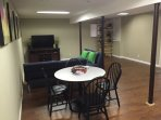 Lower level with 2 full size futons, tv area and game table