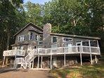 HUGE home with over 3,000 sqft, 3 large decks  and screened three season room.