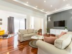 Spacious living and dining area with TV