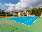 Hard tennis court equipped with racquets