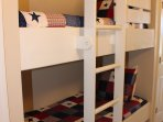 Bunk beds for kids in the hallway.