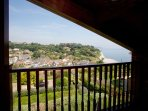 The master bedroom balcony commands magnificent views over the village and harbour