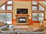 Relax in front of the 65' SmartTV or get cozy by the indoor/outdoor fireplac