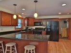 Spacious kitchen and breakfast bar with granite countertops