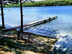 Summer view of beach area, bench and 12' rowboat