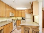 Relax over coffee at the breakfast bar while planning out your day. The fully stocked kitchen gives you the option to...
