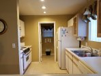 Full Sized Kitchen and Laundry Room