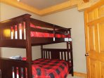Bunk room entry level double over double on one side of the room