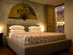The second bedroom is comfortable with garden view and similar setting with the master bedroom