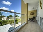 Enjoy views of the sparkling pool and gorgeous surroundings from the unit's private balcony.
