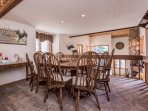 dining table with window seat and three kitchen bar stools