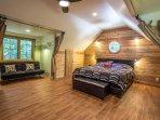 bed in upper level studio