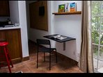 Small desk and chair provide usable work space for students or guests on a working vacation.