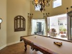 Keep the group entertained with a game of billiards on the pool table.