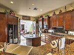 The fully equipped kitchen is a chef's dream, with a granite breakfast bar, double ovens and a kitchen island for extra...