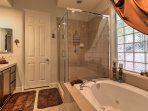 This master suite features a soaking tub and walk-in shower.