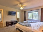 The master suite features a personal Smart TV and en-suite bathroom.