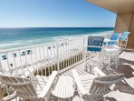 High end patio furniture on this spacious beach front balcony.