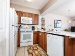Quartz countertops, smooth top stove and spacious cabinets along