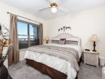 What a lovely bedroom!  King size bed, wall mounted TV.