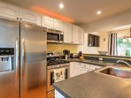 The fully equipped kitchen comes complete with stainless steel appliances.