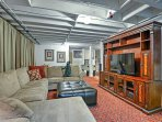 Have a movie night on the flat-screen cable TV as you get comfy on the large sectional couch.