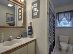The first bathroom offers a shower/tub combo.
