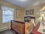 Turn on the flat-screen cable TV in the second bedroom and rest your head on the full-sized bed.