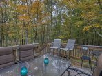 Have a barbecue on the deck featuring an outdoor table and chairs and a gas grill.
