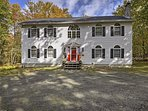 This colonial-style home boasts 4,000 square feet and accommodations for 9 guests with room for 1 more.