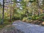 Enjoy the peaceful atmosphere from this wooded property.