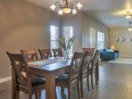 Share a meal at the 8-person dining table.