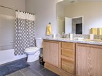 Tidy up in the master bath, offering a shower/tub combo.