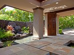 Grand entrance with pond and waterfall features and lush landscaping.