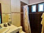Studio bathroom with rain showerhead.