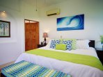 3rd Floor Master bedroom with king bed, large ocean-view terrace and private bathroom.