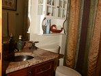 2nd bathroom - main floor: toilet, sink, tub, and shower.