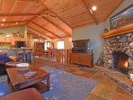 Upstairs great room with large fireplace and deck access