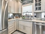 Stainless steel appliances and bright granite countertops set the tone for a chic cooking experience.