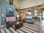 The open floor plan delivers a cohesive space outfitted with soothing earth tones and nautical decor throughout.
