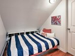Two additional travelers can makes themselves comfortable on this cozy full bed.