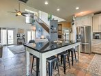 Share the catch of the day around this standalone island that features bar seating for 6!