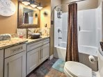It'll be easy to stick to your morning routine in this upgraded bathroom that offers a shower/tub combo.