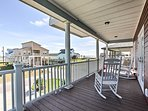 Enjoy your favorite beverage on this covered porch before you explore the Kelly Hamby Nature Trail.