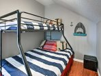 Perfect for the youngsters, this unique bunk room offers a twin-over-full bunk set.