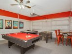 Game room with AC, billiards, foosball, air hockey, TV and pub table and chairs