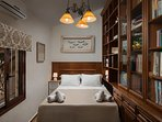 BEDROOM WITH DOUBLE BED AND A LIBRARY