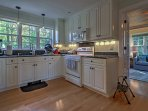 The kitchen is fully equipped with updated appliances and granite counters.