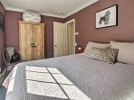 Lie back on the queen bed in the purple bedroom.