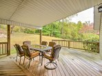 When the weather is bad, you can still enjoy being outside on the covered deck with an outdoor table set for 6.